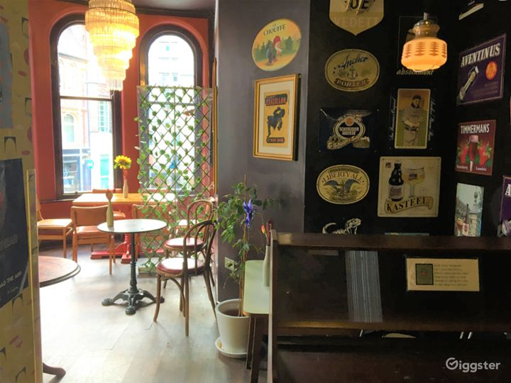 Beer signs, chandelier, retro wallpaper.   This room can be made private with the rest of upstairs