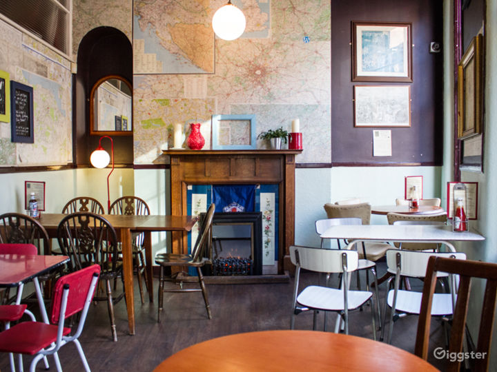 Small private room upstairs overlooking John Bright Street.  Map decoupaged walls, fireplace, traditional style dado rail