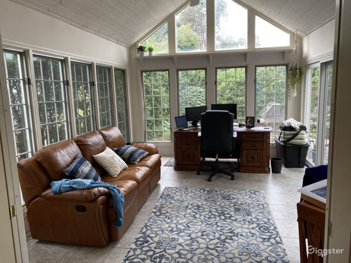 Four-season room with sliding doors to patio and vaulted ceiling