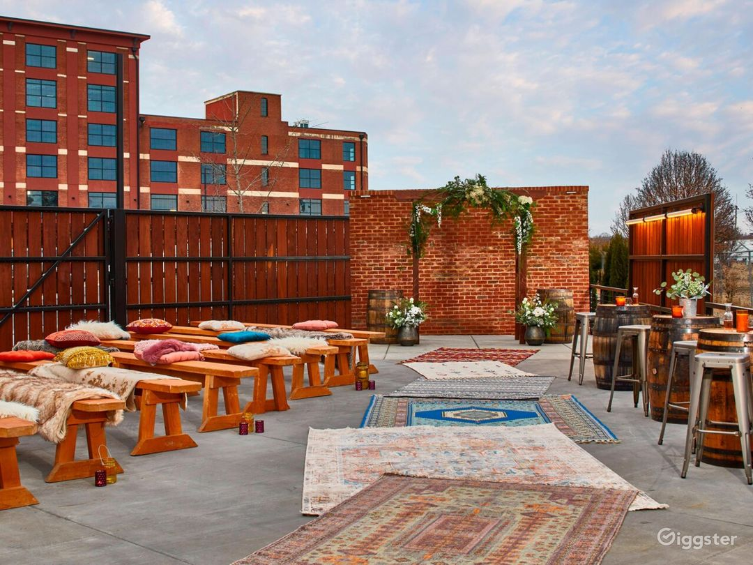 The Railyard Set for a Wedding (Rugs, Benches, Pillows, Blankets, Barrels, Barstools, Tables & Chairs are included with space rental)