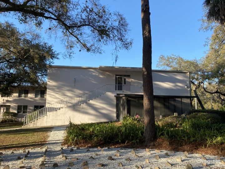 Mid century building with 8 acres of riverfront Photo 3