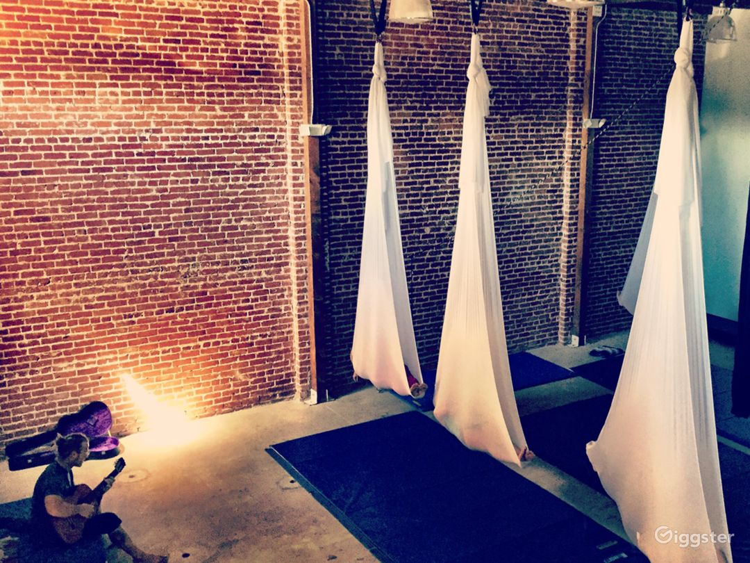 1920s, brick wall, 26'wood ceiling, event space. Photo 1