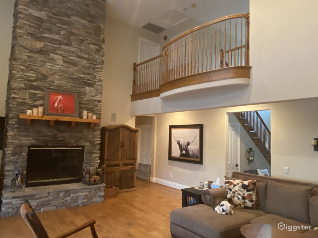 Family room and 2-story fireplace. Balcony from upstairs.