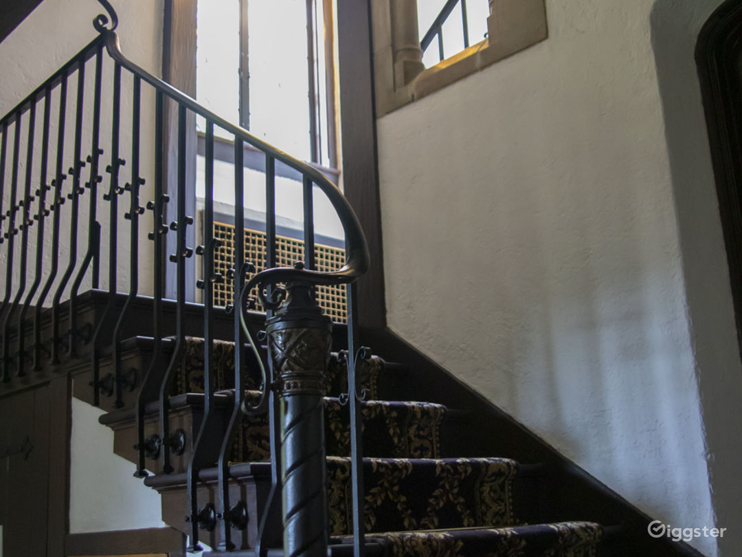 Tudor Stairway with hand forged iron and stone accents