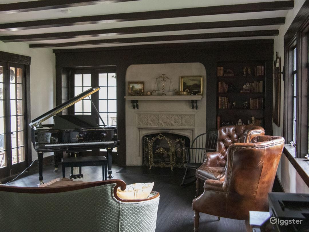 1926 Original Living Room with original windows, door and mantel.