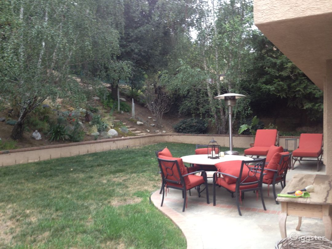 Back yard with landscaping on rear slant, fenced yard, backs to open space