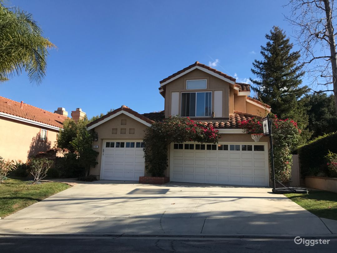 From street, nice suburban home in quiet family cul-de-sac