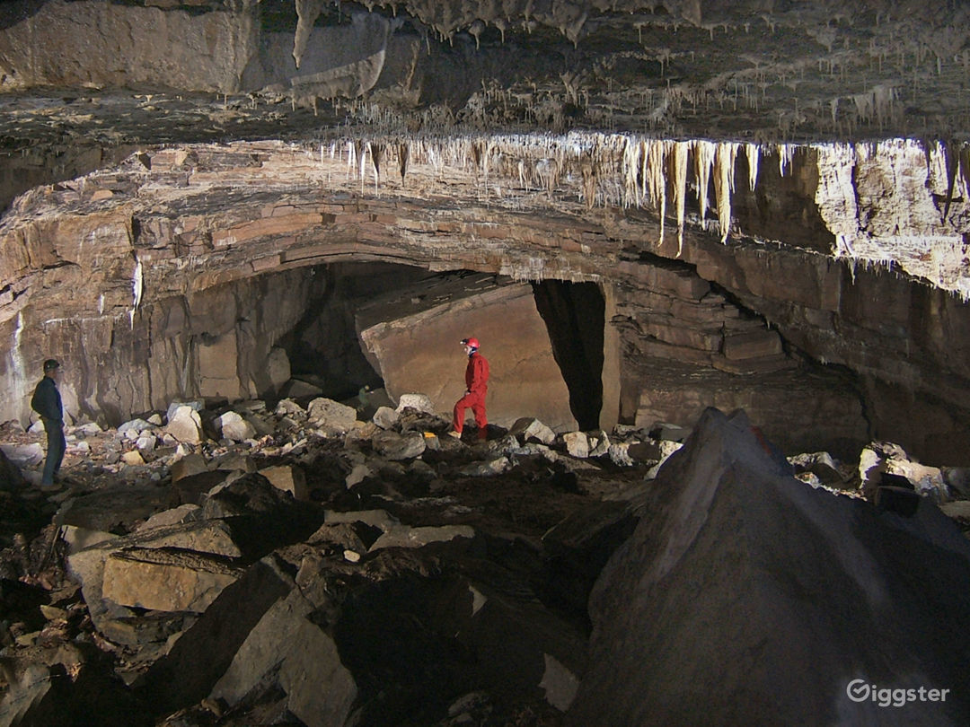 Large passages are found in the caves on this property. In this passage, called the Subway, there is a large rock. Notice the tiny image of a person beside the rock.