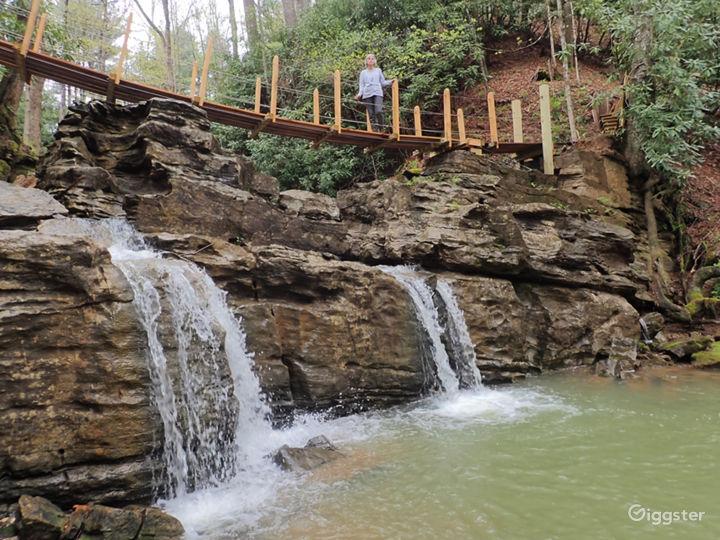 This swinging bridge crosses a waterfall ledge.