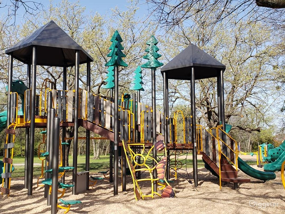 Bright Open Plaza and Playground Photo 1