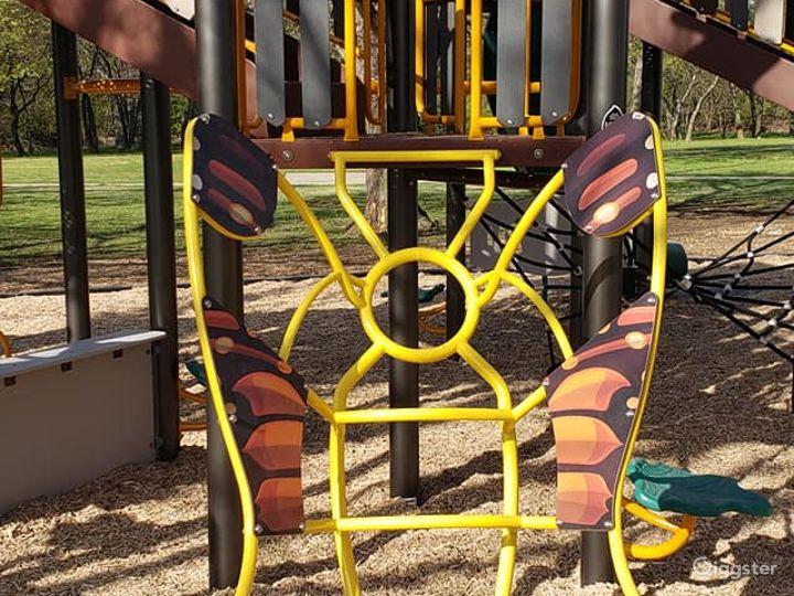 Bright Open Plaza and Playground Photo 5