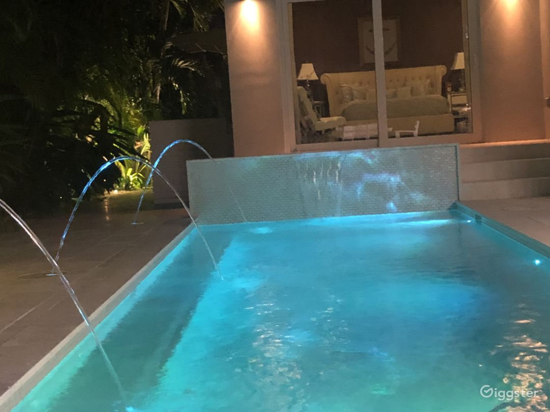 Beautiful pool with waterfall and water features. Multi color lighting.
