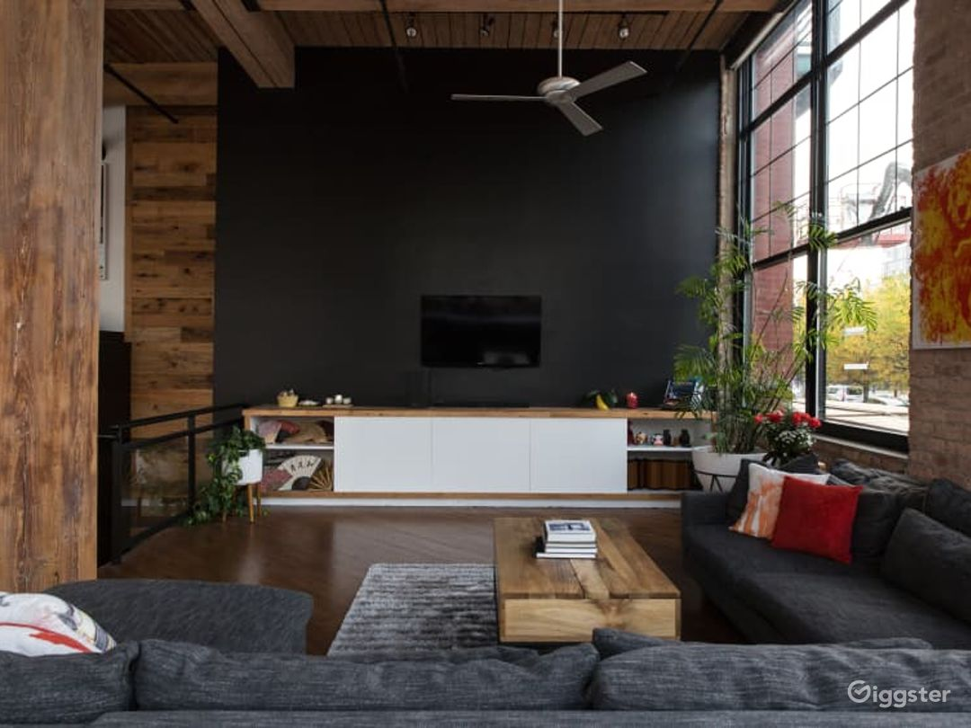 Living room with built-in cabinetry and comfy couch