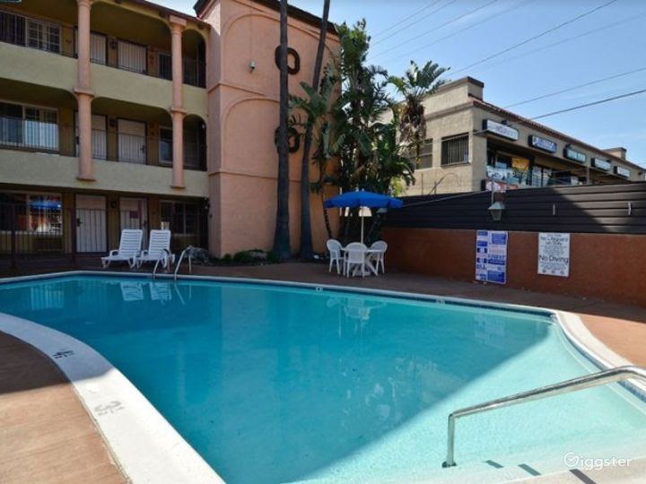 Sunny Outdoor Pool Photo 2