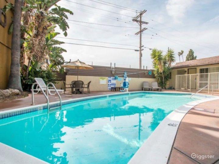 Sunny Outdoor Pool Photo 4