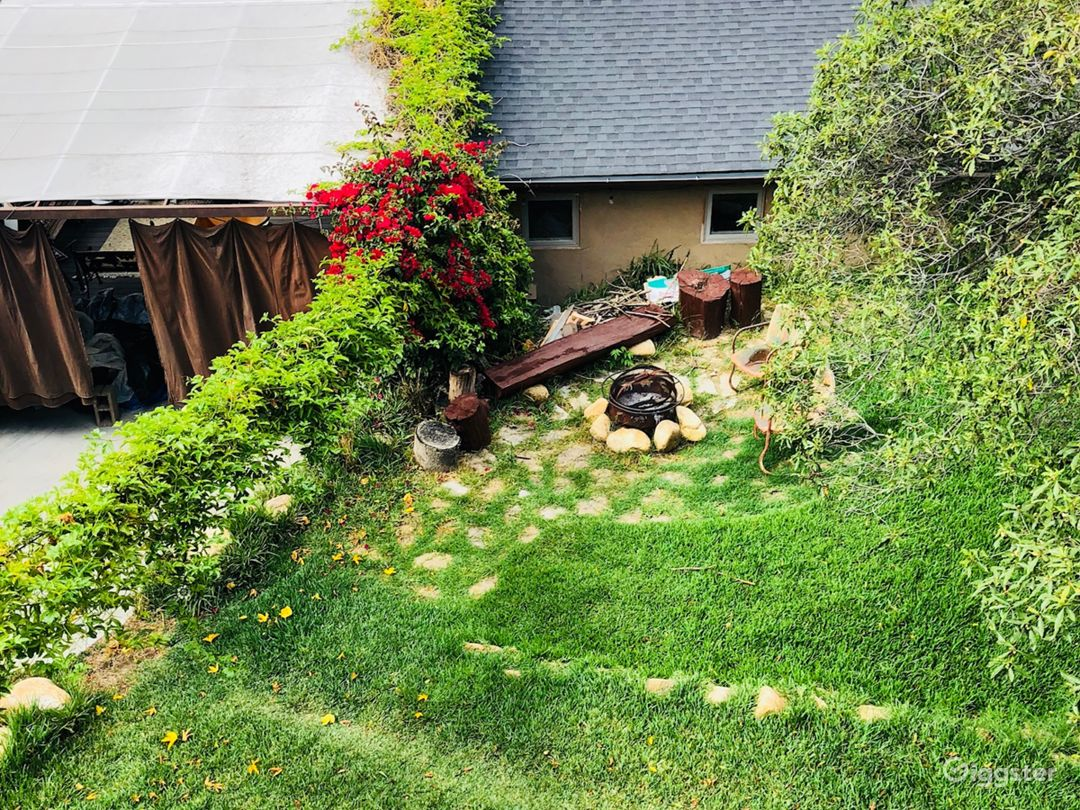 Lush backyard with fire pit, vertical garden, hammock. Just beyond the yard we have a music studio and deck with a vintage Scamp camper available for an additional fee.
