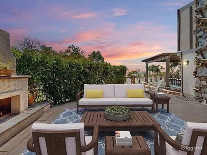Outdoor patio and fireplace lounge area