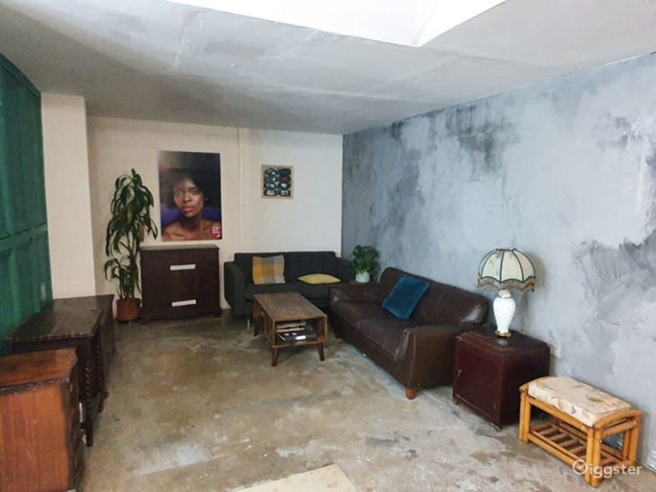 Lounge Space with Concrete Aesthetic And Green Panel Walls  Photo 2