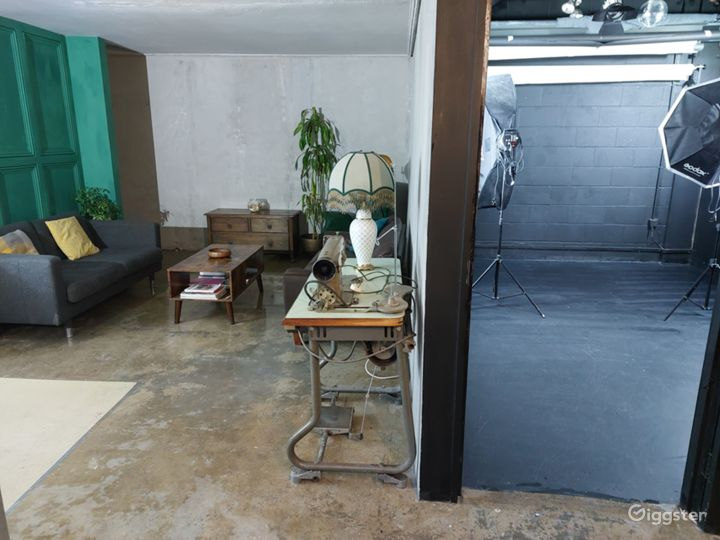 Lounge Space with Concrete Aesthetic And Green Panel Walls  Photo 4