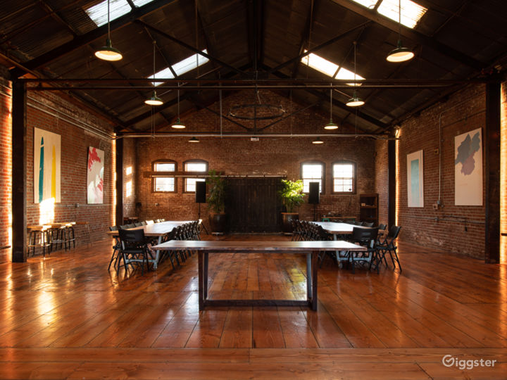 View from Front: One 8ft. Wooden Table, Two 6ft Wooden Tables, Two 12ft Wooden Tables, and 60 Black Folding Chairs