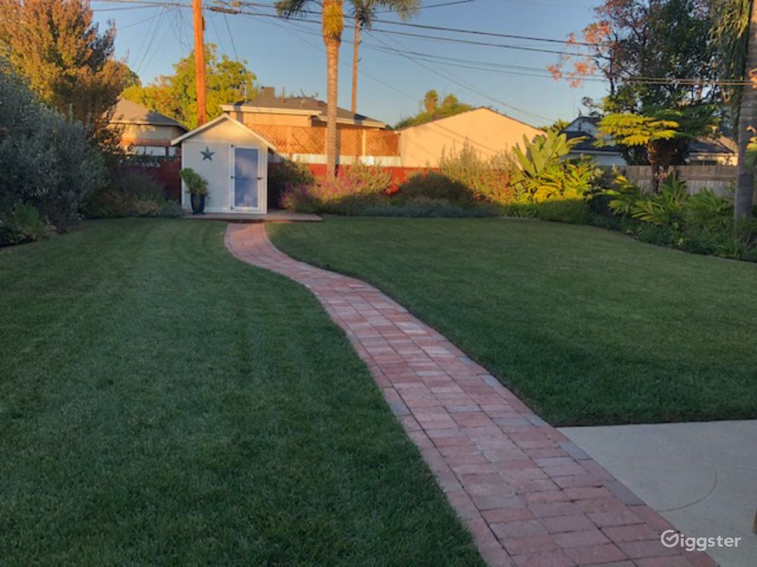 Partial view of approx. 5,000 sa.ft. landscaped backyard.