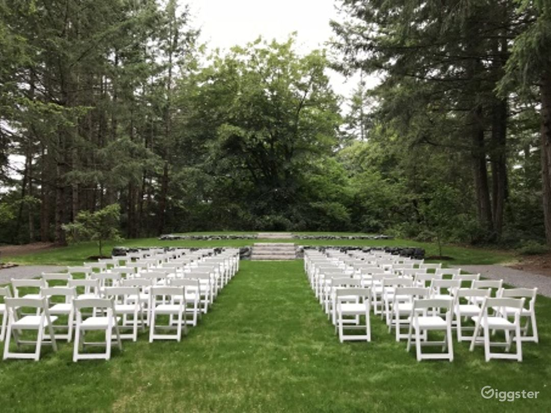Event Space Canopied by Evergreen Trees Photo 1