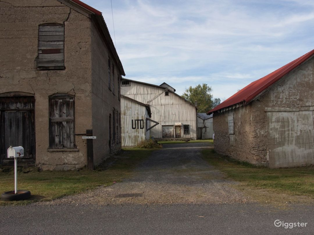 Mid 19th Century factory consisting of several buildings set on 2 acres. The property is currently being used as an art/industrial/event space including Blacksmith shop, steel fab and wood working space.