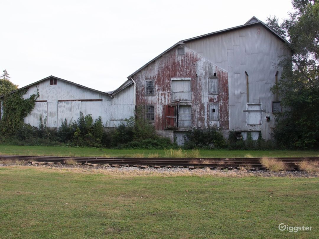 Rear view.  The factory sits on live railroad tracks.