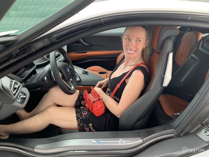 Custom build i8 with blue seatbelts and orange leather seat