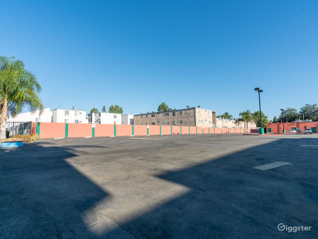 NEW-Empty Parking Structure with brick buildings  Photo 1