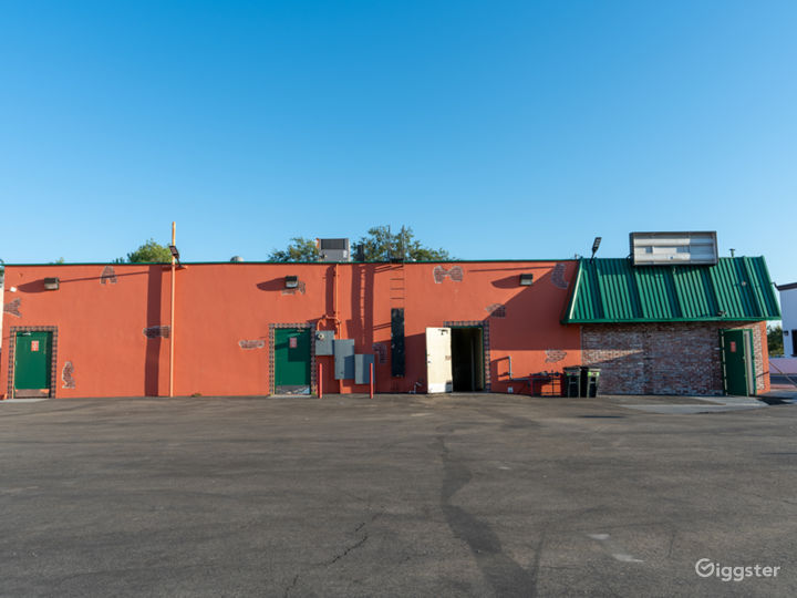 NEW-Empty Parking Structure with brick buildings  Photo 4