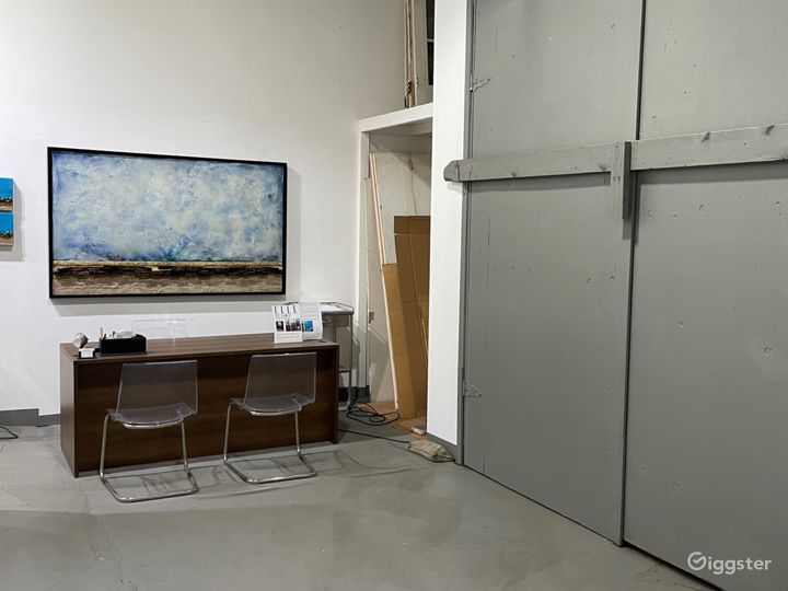 View of the front desk and barn doors looking towards the east wall of the gallery