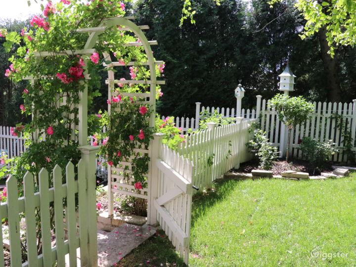 Stunning English garden/rose arbor/pergola on lake