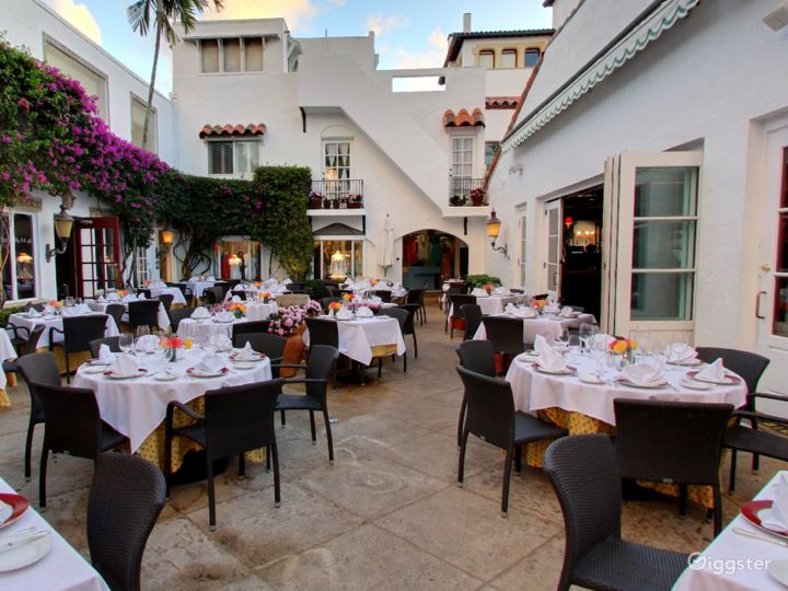 Rustic Outdoor Dining Space in Palm Beach Photo 2