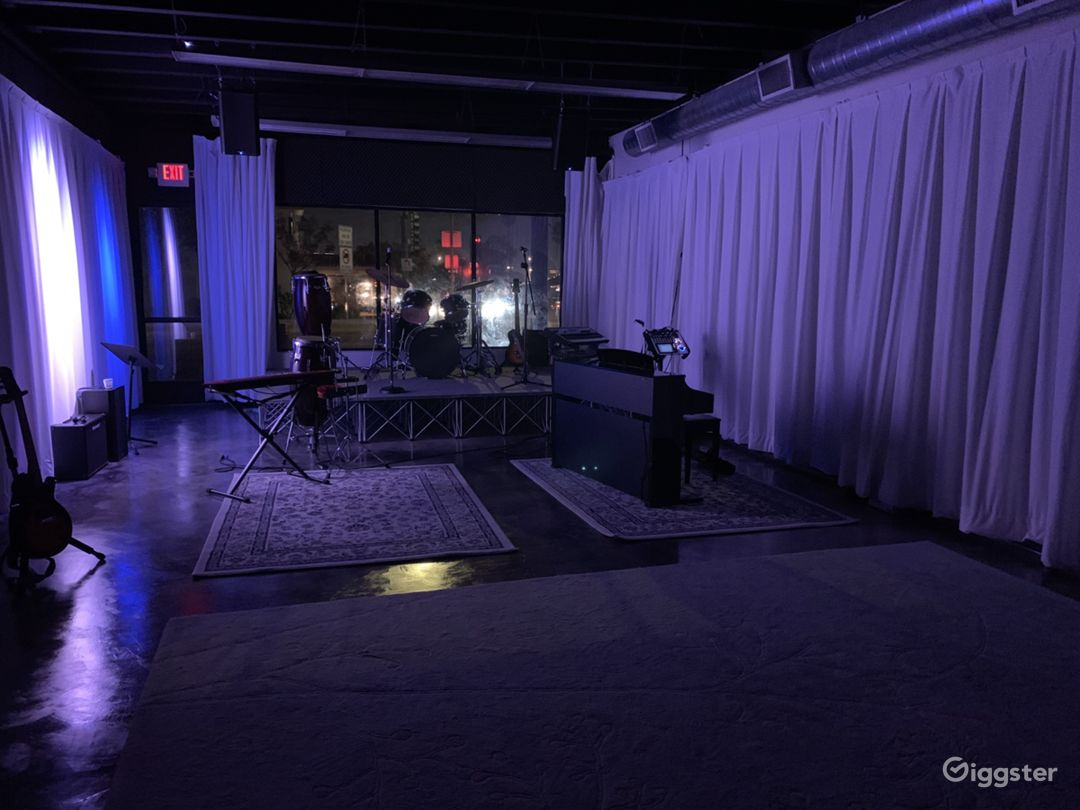 800 Square Foot Band Performance Room at Night