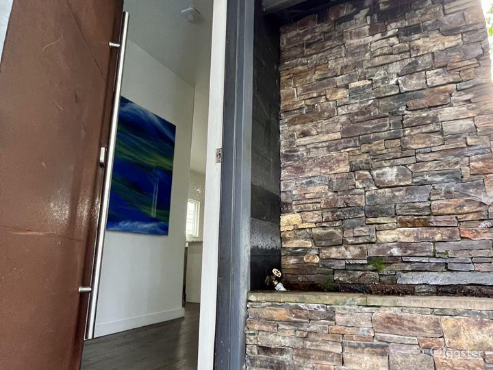 Front door waterfall wall & industrial metal door.