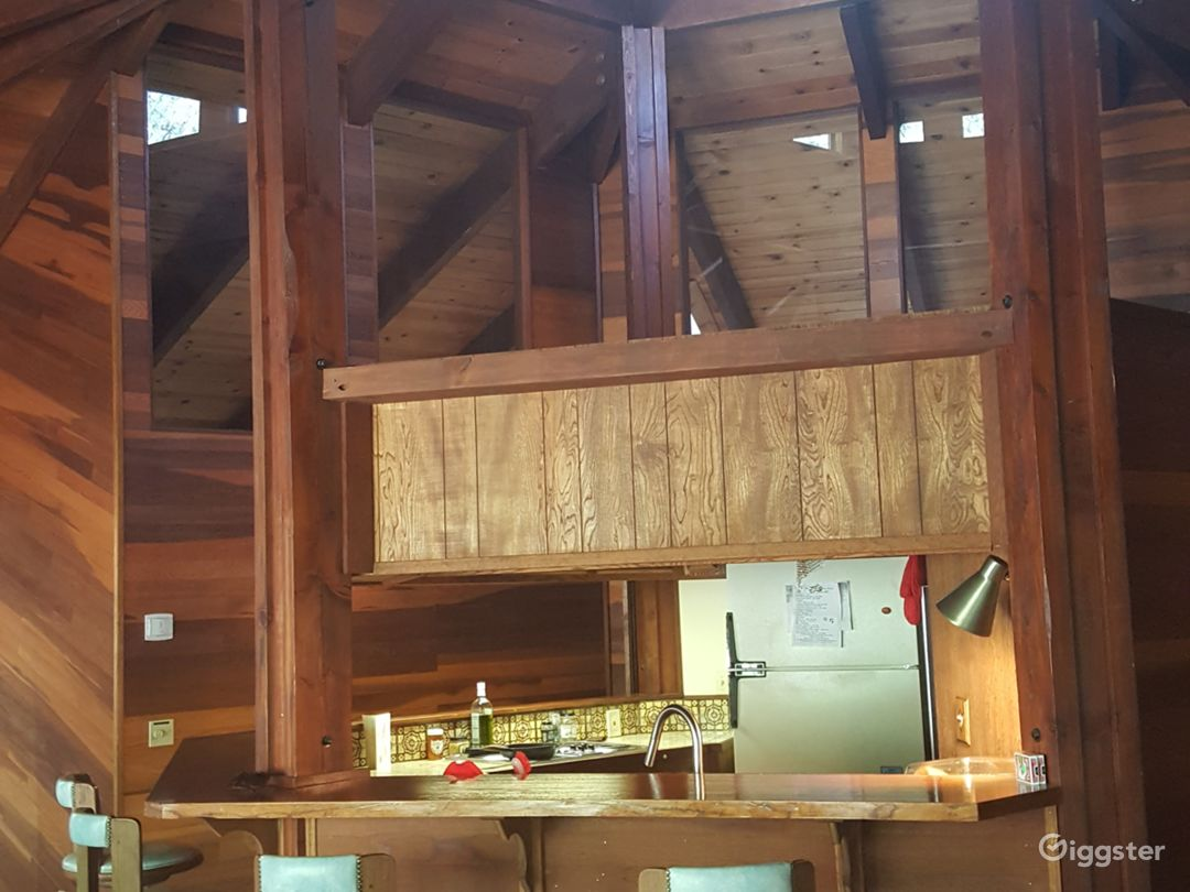 Massive peak above the central vintage kitchen that connects the 8 sides of the octagon home.