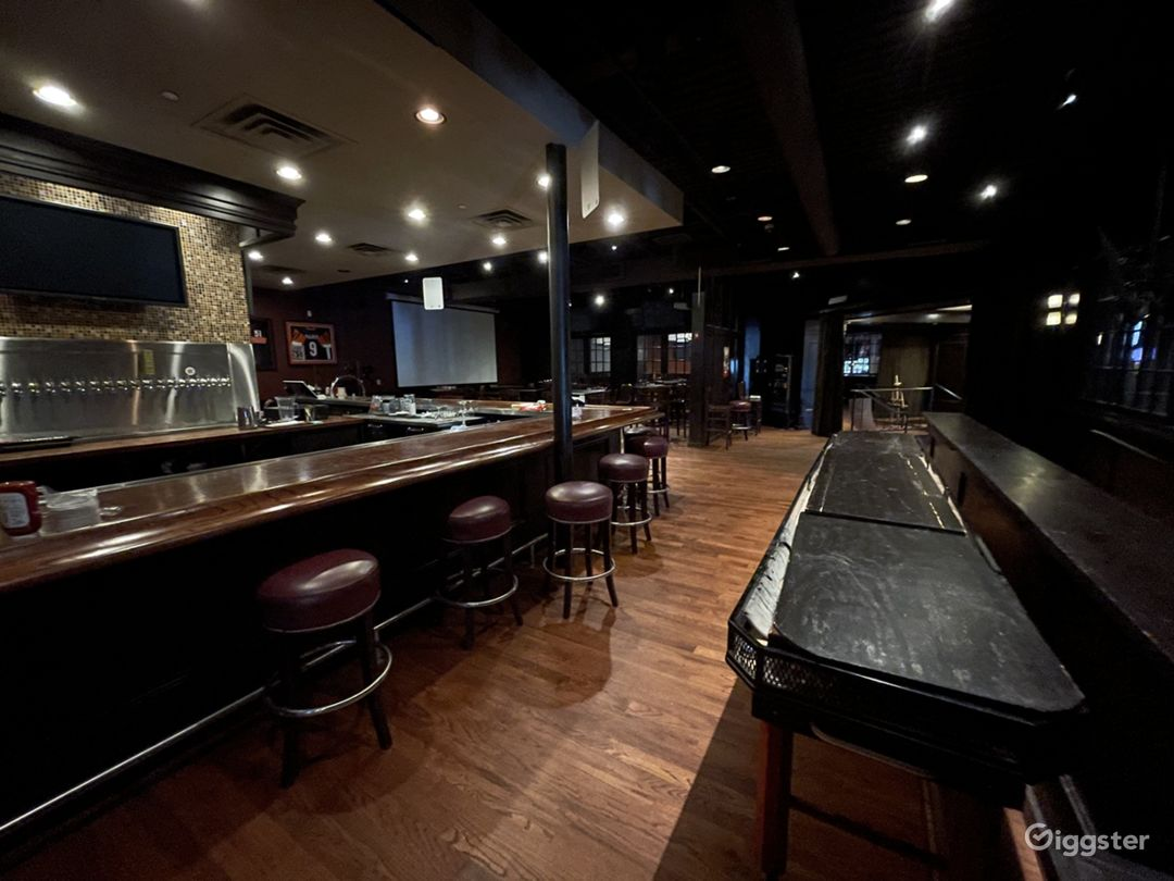Private bar; bar seating for 20, projector screen and seat for 50