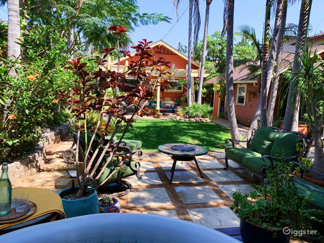 View of our fire pit, lawn and outdoor lounge area from our jacuzzi.