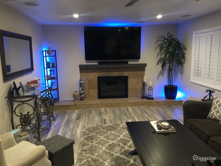 Philips hue lighting hidden throughout living room (even under sectional couch) also kitchen. Any color possible!