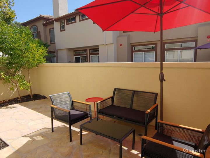backyard/patio with conversation set, lemon tree