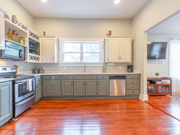 The kitchen is large with high ceilings and original windows, and fully stocked.