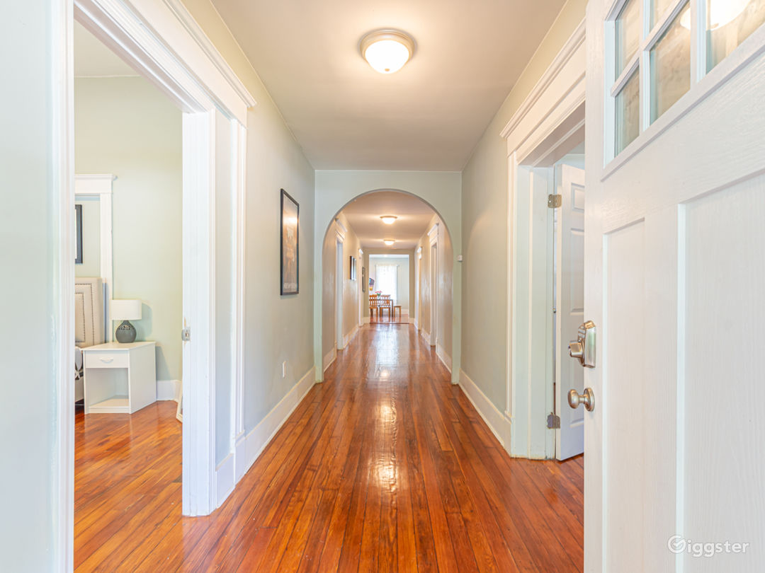 Unit A feels grandiose with its wide hallways and historic feel