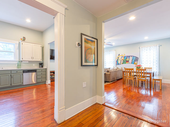 At the end of the hall, the open concept kitchen flows into the family room.